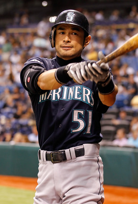 ST. PETERSBURG, FL - AUGUST 19:  Outfielder Ichiro Suzuki #51 of the Seattle Mariners warms up against the Tampa Bay Rays during the game at Tropicana Field on August 19, 2011 in St. Petersburg, Florida.  (Photo by J. Meric/Getty Images)