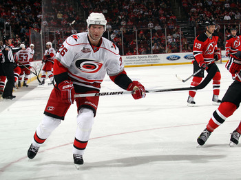 NEWARK, NJ - FEBRUARY 16:  Erik Cole #26 of the Carolina Hurricanes skates against the New Jersey Devils at the Prudential Center on February 16, 2011 in Newark, New Jersey.  (Photo by Bruce Bennett/Getty Images)