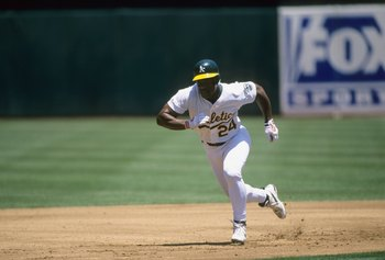 OAKLAND, CA - JUNE 13:  Rickey Henderson #24 of the Oakland Athletics runs the bases during the game against the Seattle Mariners at Network Associates Coliseum on June 13, 1998 in Oakland, California. (Photo by Otto Greule Jr/Getty Images)