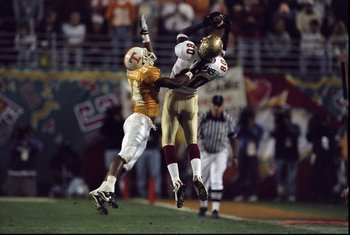 4 Jan 1999:  Ron Dugans #80 of the Florida State Seminoles catching a pass while being guarded by Steve Johnson #34 during the Tostitos Fiesta Bowl Game against the Tennessee Volunteers at the Sun Devil Stadium in Tempe, Arizona. The Volunteers defeated t