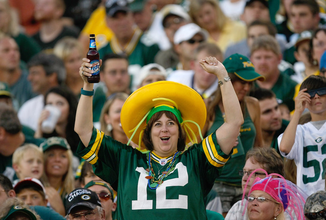 GREEN BAY, WI - AUGUST 19: A Packers fan cheers after a packers touchdown during the game between the Arizona Cardinals  against the Green Bay Packers in a preseason game at Lambeau Field on August 19, 2011 in Green Bay, Wisconsin. (Photo by Scott Boehm/G