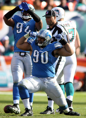 MIAMI - DECEMBER 26:  Lineman Ndamukong Sue #90 celebrates a sack against the Miami Dolphins at Sun Life Stadium on December 26, 2010 in Miami, Florida.  (Photo by Marc Serota/Getty Images)
