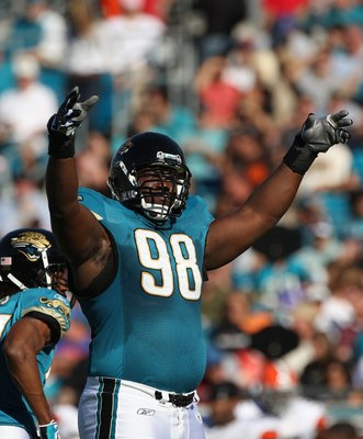 JACKSONVILLE, FL - OCTOBER 26:  John Henderson #98 of the Jacksonville Jaguars asks the crowd for noise in a game against the Cleveland Browns at Jacksonville Muncipal Stadium on October 26, 2008 in Jacksonville, Florida.  (Photo by Sam Greenwood/Getty Im