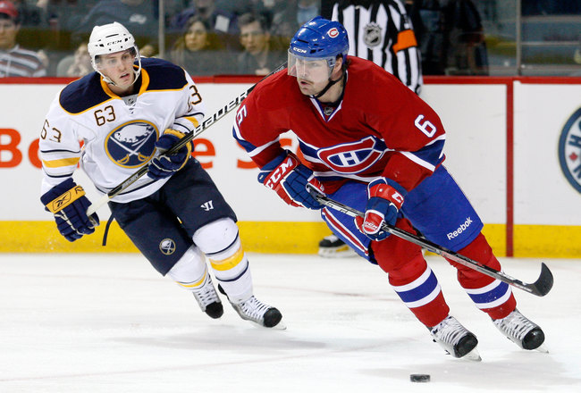 MONTREAL- NOVEMBER 27:  Jaroslav Spacek #6 of the Montreal Canadiens skates with the puck while being followed Tyler Ennis #63 of the Buffalo Sabres during the NHL game at the Bell Centre on November 27, 2010 in Montreal, Quebec, Canada.  The Canadiens de
