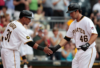 PITTSBURGH - AUGUST 21:  Garrett Jones #46 of the Pittsburgh Pirates is congratulated by teammate Jose Tabata #31 after hitting a three run home run in the 6th inning against the Cincinnati Reds during the game on August 21, 2011 at PNC Park in Pittsburgh