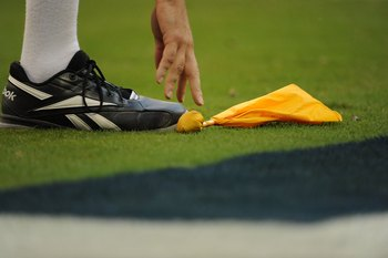 HOUSTON - OCTOBER 19:  An NFL official picks up a penalty flag during play between the Detroit Lions and the Houston Texans at Reliant Stadium on October 19, 2008 in Houston, Texas.  (Photo by Ronald Martinez/Getty Images)