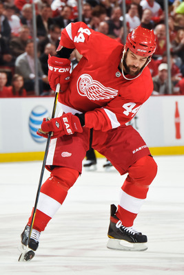 DETROIT - MAY 4: Todd Bertuzzi #44 of the Detroit Red Wings skates with the puck against the San Jose Sharks in Game Three of the Western Conference Semifinals during the 2011 NHL Stanley Cup Playoffs on May 4, 2011 at Joe Louis Arena in Detroit, Michigan