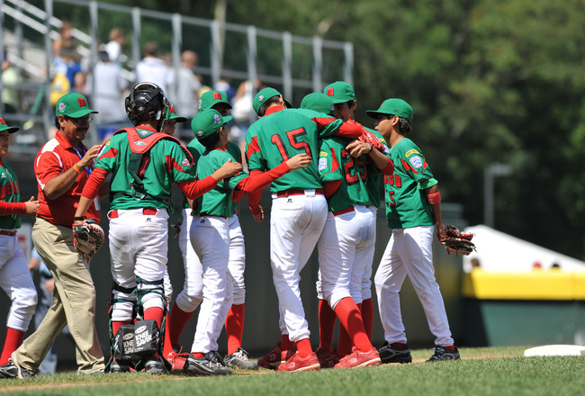 WILLIAMSPORT, PA - AUGUST 30: Mexico (Reynosa) celebrates their win against Texas (San Antonio) in the consolation game at Volunteer Stadium on August 30, 2009 in Williamsport, Pennsylvania. Mexico defeated Texas 5-4. (Photo by Larry French/Getty Images)