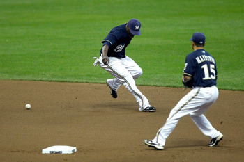 MILWAUKEE, WI - AUGUST 17: Yuniesky Betancourt #3 of the Milwaukee Brewers drops the baseball for an error as Jerry Hairston Jr. #15 looks on against the Los Angeles Dodgers at Miller Park on August 17, 2011 in Milwaukee, Wisconsin. (Photo by Scott Boehm/