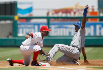 ANAHEIM, CA - JULY 21:  Elvis Andrus #1 of the Texas Rangers is tagged out by third baseman Alberto Callaspo #6 of the Los Angeles Angels of Anaheim on a steal attempt in the first inning at Angel Stadium of Anaheim on July 21, 2011 in Anaheim, California