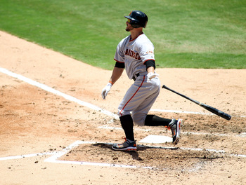 MIAMI GARDENS, FL - AUGUST 14:  Cody Ross #13 of the San Francisco Giants hits a two run home run against the Florida Marlins at Sun Life Stadium on August 14, 2011 in Miami Gardens, Florida.  (Photo by Marc Serota/Getty Images)