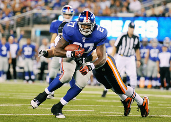 EAST RUTHERFORD, NJ - AUGUST 22:  Brandon Jacobs #27 of the New York Giants runs the ball against the Chicago Bears during a pre season game at New Meadowlands Stadium on August 22, 2011 in East Rutherford, New Jersey.  (Photo by Patrick McDermott/Getty I