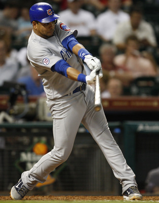 HOUSTON, TX - AUGUST 15: Third baseman Aramis Ramirez #16 of the Chicago Cubs connects for a single in the seventh inning against the Houston Astros on August 15, 2011 at Minute Maid Park in Houston, Texas. (Photo by Eric Christian Smith/Getty Images)