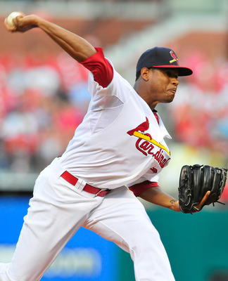 ST. LOUIS, MO - AUGUST 14: Edwin Jackson #22 of the St. Louis Cardinals throws to a Colorado Rockies batter at Busch Stadium on August 14, 2011 in St. Louis, Missouri.  (Photo by Jeff Curry/Getty Images)