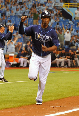 ST. PETERSBURG, FL - AUGUST 4:  Outfielder B. J. Upton #2 of the Tampa Bay Rays scores in the 12th inning against the Toronto Blue Jays August 4, 2011 at Tropicana Field in St. Petersburg, Florida. The Rays defeated the Blue Jays 7-6 in 12 innings.  (Phot
