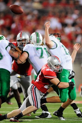 COLUMBUS, OH - SEPTEMBER 2:  Tyler Moeller #26 of the Ohio State Buckeyes sacks quarterback Brian Anderson #12 of the Marshall Thundering Herd causing a fumble at Ohio Stadium on September 2, 2010 in Columbus, Ohio.  (Photo by Jamie Sabau/Getty Images)