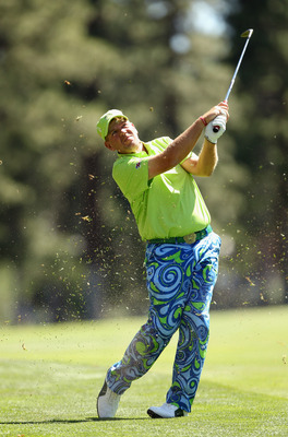 RENO, NV - AUGUST 04:  John Daly hits his approach shot on the eighth hole during round one of the Reno-Tahoe Open on August 4, 2011 in Reno, Nevada.  (Photo by Ezra Shaw/Getty Images)