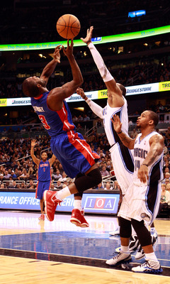 ORLANDO, FL - JANUARY 24:   Rodney Stuckey #3 of the Detroit Pistons attempts a shot against Dwight Howard #12 and Jameer Nelson #14 of the Orlando Magic during the game at Amway Arena on January 24, 2011 in Orlando, Florida.  NOTE TO USER: User expressly