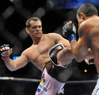 DALLAS - SEPTEMBER 19:  UFC fighter Vitor Belfort (R) battles UFC fighter Rich Franklin (L) during their Catch weight bout at UFC 103: Franklin vs. Belfort at the American Airlines Center on September 19, 2009 in Dallas, Texas.  (Photo by Jon Kopaloff/Get