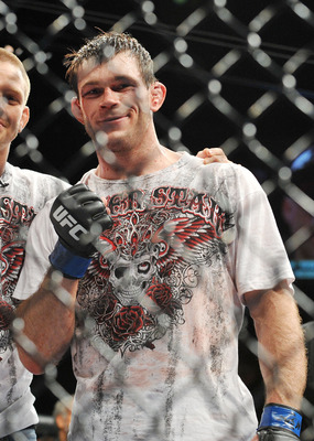 LAS VEGAS - NOVEMBER 21:  Forrest Griffin celebrates his victory over Tito Ortiz after their Light Heavyweight Fight at the UFC 106 at Mandalay Bay Events Center on November 21, 2009 in Las Vegas, Nevada.  (Photo by Jon Kopaloff/Getty Images)