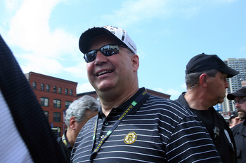 BOSTON, MA  - JUNE 18: Claude Julien of the Boston Bruins reacts to cheers during the Stanley Cup victory parade on June 18, 2011 in Boston, Massachusetts.  (Photo by Jim Rogash/Getty Images)