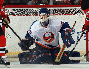 NEWARK, NJ - MARCH 30:  Rick DiPietro #39 of the New York Islanders tends net against the New Jersey Devils at the Prudential Center on March 30, 2011 in Newark, New Jersey. The Devils defeated the Islanders 3-2.  (Photo by Bruce Bennett/Getty Images)