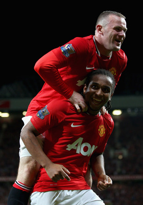 MANCHESTER, ENGLAND - AUGUST 22:  Anderson of Manchester United celebrates scoring his side's second goal with team mate Wayne Rooney during the Barclays Premier League match between Manchester United and Tottenham Hotspur at Old Trafford on August 22, 20