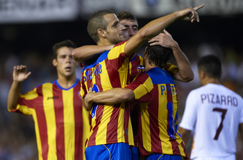 VALENCIA, SPAIN - AUGUST 12:  Roberto Soldado of Valencia celebrate with his teammate after scoring during the Orange Trophy match between Valencia and Roma at Estadio Mestalla on August 12, 2011 in Valencia, Spain.  (Photo by Manuel Queimadelos Alonso/Ge