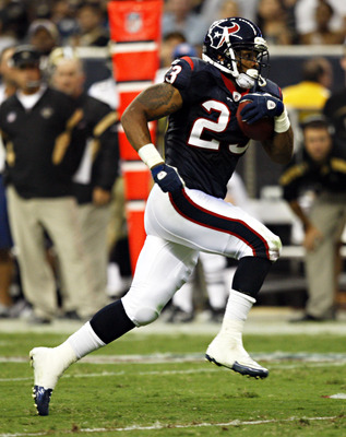 HOUSTON - AUGUST 20:  Running back Arian Foster #23 of the Houston Texans rushes against the New Orleans Saints in the first quarter at Reliant Stadium on August 20, 2011 in Houston, Texas.  (Photo by Bob Levey/Getty Images)