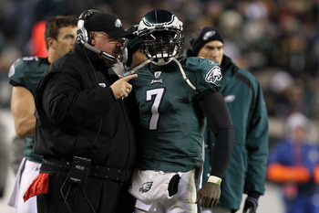 PHILADELPHIA, PA - DECEMBER 02:  Head coach Andy Reid and Michael Vick #7 of the Philadelphia Eagles talk on the sideline against the Houston Texans at Lincoln Financial Field on December 2, 2010 in Philadelphia, Pennsylvania.  (Photo by Al Bello/Getty Im