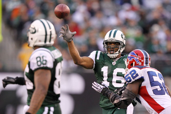 EAST RUTHERFORD, NJ - JANUARY 02:  Brad Smith #16 of the New York Jets passes the ball against Arthur Moats #52 of the Buffalo Bills at New Meadowlands Stadium on January 2, 2011 in East Rutherford, New Jersey.  (Photo by Al Bello/Getty Images)