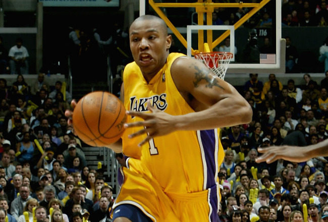 LOS ANGELES - DECEMBER 28:  Caron Butler #1 of the Los Angeles Lakers drives with the ball against the Toronto Raptors on December 28, 2004 at Staples Center in Los Angeles, California.   The Lakers won 117-99.  NOTE TO USER: User expressly acknowledges a