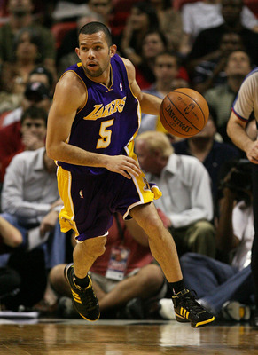 MIAMI - DECEMBER 19:  Jordan Farmar #5 of the Los Angeles Lakers brings the ball upcourt against the Miami Heat at American Airlines Arena on December 19, 2008 in Miami, Florida. NOTE TO USER: User expressly acknowledges and agrees that, by downloading an