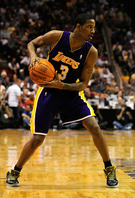 ORLANDO, FL - DECEMBER 20:  Trevor Ariza #3 of the Los Angeles Lakers looks to pass in a game against the Orlando Magic on December 20, 2008 at Amway Arena in Orlando, Florida.  NOTE TO USER: User expressly acknowledges and agrees that, by downloading and