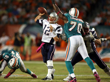 MIAMI - OCTOBER 04:  Quarterback Tom Brady #12 of the New England Patriots throws against the Miami Dolphins at Sun Life Stadium on October 4, 2010 in Miami, Florida.  (Photo by Marc Serota/Getty Images)