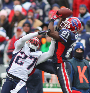 ORCHARD PARK, NY - DECEMBER 26:  C.J. Spiller #21 of the Buffalo Bills makes a catch against Kyle Arrington #27 of the New England Patriots at Ralph Wilson Stadium on December 26, 2010 in Orchard Park, New York.  (Photo by Rick Stewart/Getty Images)