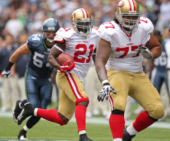 SEATTLE - SEPTEMBER 12:  Running back Frank Gore #21 of the San Francisco 49ers rushes as Mike Iupati #77 blocks for him during the NFL season opener against the Seattle Seahawks at Qwest Field on September 12, 2010 in Seattle, Washington. (Photo by Otto