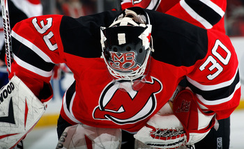 NEWARK, NJ - APRIL 02:  Goalie Martin Brodeur #30 of the New Jersey Devils looks down during a timeout in an NHL hockey game against the Montreal Canadians at the Prudential Center on April 2, 2011 in Newark, New Jersey.  (Photo by Paul Bereswill/Getty Im
