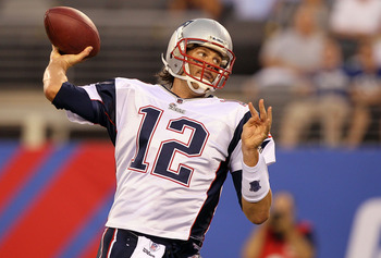 EAST RUTHERFORD, NJ - SEPTEMBER 02:  Tom Brady #12 of the New England Patriots throws a first quarter pass against the New York Giants on September 2, 2010 at the New Meadowlands Stadium in East Rutherford, New Jersey.  (Photo by Jim McIsaac/Getty Images)