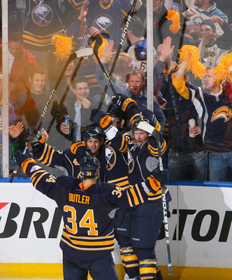 BUFFALO, NY - APRIL 24: Nathan Gerbe #42 (left facing) of the Buffalo Sabres celebrates with teammates after scoring Bufffalo's fourth goal against the Philadelphia Flyers in Game Six of the Eastern Conference Quarterfinals during the 2011 NHL Stanley Cup