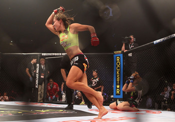 Miesha Tate celebrates after defeating Hitomi Akano.