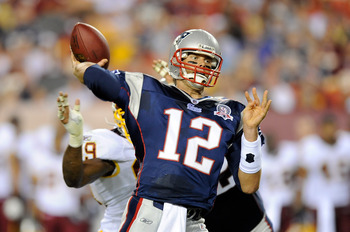 LANDOVER, MD - AUGUST 28:  Tom Brady #12 of the New England Patriots throws a touchdown to Randy Moss #81 (not pictured) in the first quarter of a preseason game against the Washington Redskins at FedExField on August 28, 2009 in Landover, Maryland.  (Pho