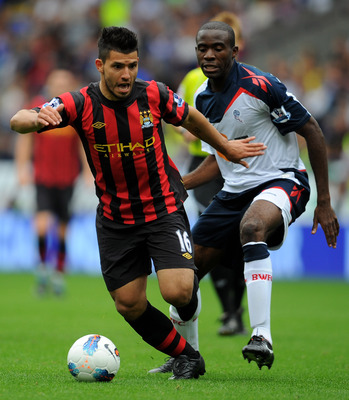 BOLTON, ENGLAND - AUGUST 21:  Sergio Aguero of Manchester City battles for the ball with Fabrice Muamba of Bolton Wanderers during the Barclays Premier League match between Bolton Wanderers and Manchester City at the Reebok Stadium on August 21, 2011 in B