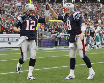 FOXBORO, MA - JANUARY 02:  Tom Brady #12of the New England Patriots celebrates the touchdown with teammate Brian Hoyer #8 in the first half against the Miami Dolphins on January 2, 2011 at Gillette Stadium in Foxboro, Massachusetts.  (Photo by Elsa/Getty