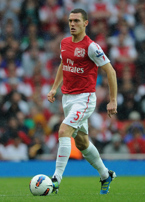 LONDON, ENGLAND - AUGUST 20:  Thomas Vermaelen of Arsenal with the ball during the Barclays Premier League match between Arsenal and Liverpool at the Emirates Stadium on August 20, 2011 in London, England.  (Photo by Michael Regan/Getty Images)