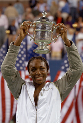 394207 01: Venus Williams celebrates after defeating her sister Serena Williams to win the women's final of the US Open September 8, 2001 in Flushing Meadows, New York. (Photo by Matthew Stockman/Getty Images)
