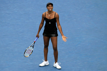NEW YORK - SEPTEMBER 10:  Venus Williams of the United States reacts after a point played against Kim Clijsters of Belgium during her women's semifinal match on day twelve of the 2010 U.S. Open at the USTA Billie Jean King National Tennis Center on Septem