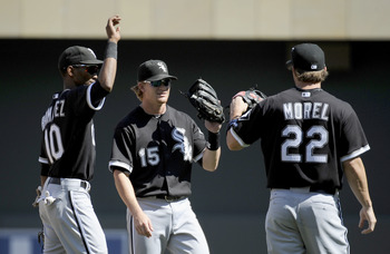 MINNEAPOLIS, MN - AUGUST 7: (L-R) Alexei Ramirez #10, Gordon Beckham #15 and Brent Morel #22 of the Chicago White Sox celebrate a win against the Minnesota Twins on August 7, 2011 at Target Field in Minneapolis, Minnesota. The White Sox defeated the Twins