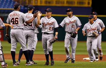 ST. PETERSBURG, FL - AUGUST 22:  Outfielders Ryan Raburn #25 and Delmon Young #21 of the Detroit Tigers celebrate their team's victory over the Tampa Bay Rays at Tropicana Field on August 22, 2011 in St. Petersburg, Florida.  (Photo by J. Meric/Getty Imag