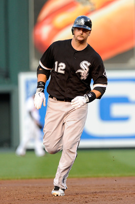 BALTIMORE, MD - AUGUST 08:  A.J. Pierzynski #12 of the Chicago White Sox rounds the bases after hitting a home run in the second inning against the Baltimore Orioles at Oriole Park at Camden Yards on August 8, 2011 in Baltimore, Maryland.  (Photo by Greg